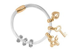 White textile bracelet with golden ring and gold charms decorations, isolated on white background, clipping path included