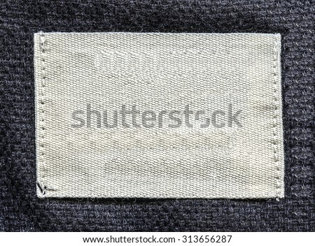 white textile tag on gray textile background