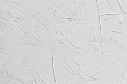 white textured background of filler paste applied with putty knife in irregular dashes and strokes