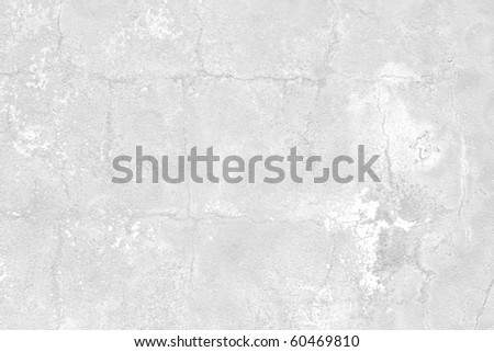 white textured wall with many cracks