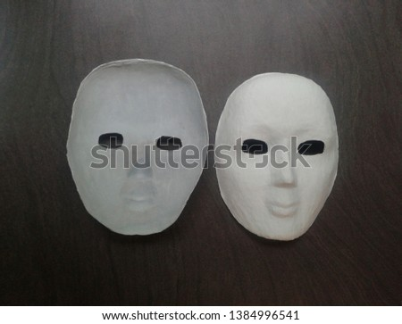 white theatrical mask on a dark background #1384996541