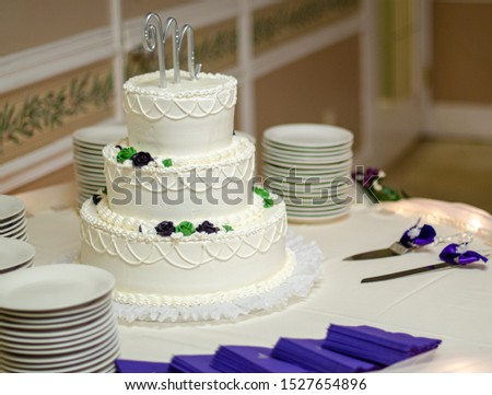 White three tier wedding cake with lace and letter M cake topper Photo stock ©