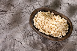 White threshed corn in the wooden bowl - Zea mays