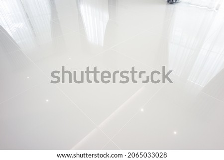 White tile floor with grid line of square texture pattern in perspective. Clean shiny of ceramic surface. Modern interior home design for bathroom, kitchen and laundry room. Empty space for background