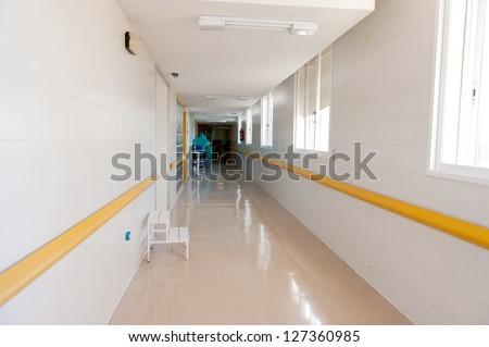 White tiled hospital corridor