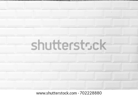 white tiles background. closed up of white glossy ceramic brick tiles wall texture, soft window light.