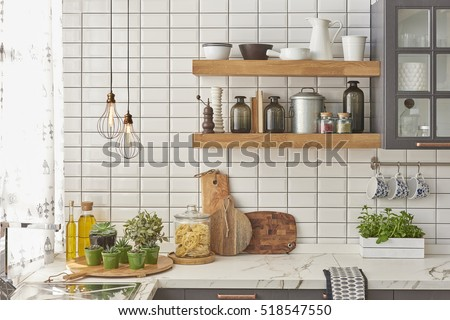 white tiles wall modern kitchen with chopping board, modern lamp #518547550