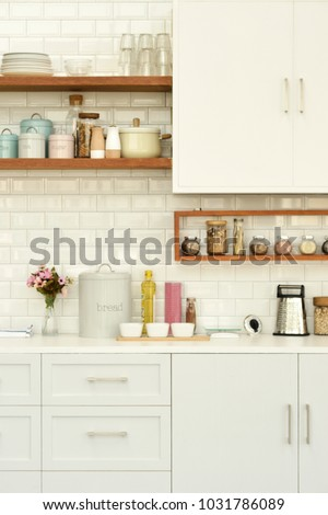 White tiles wall modern kitchen with white top background and ingredients #1031786089