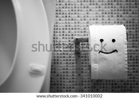 White toilet bowl and Toilet Paper.