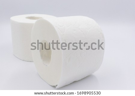 White toilet paper, rolled,  on white, background, copy space. Сток-фото ©