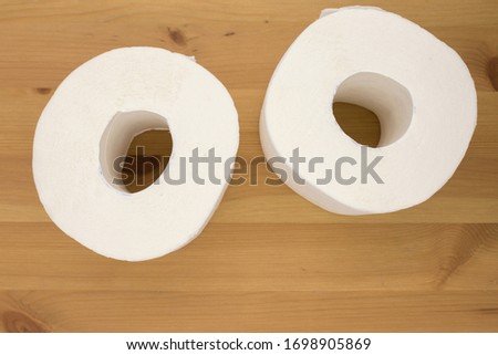 White toilet paper, rolled,  on wooden  background, copy space. Сток-фото ©