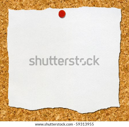 White torn paper attached to a cork noticeboard.