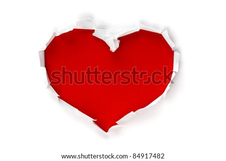 White torn paper in heart shape symbol over red background for message
