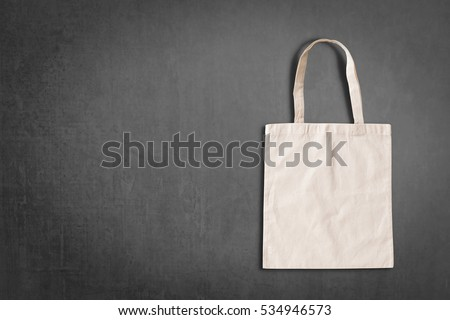 White tote bag mockup canvas fabric cloth eco shopping sack blank template isolated on blackboard background with copyspace