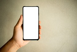 White touch screen mobile phone in hand Maine cement background