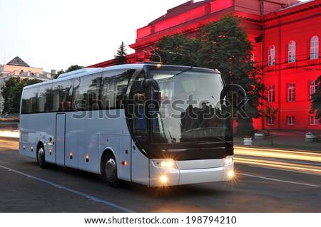 white tourist bus of city lights