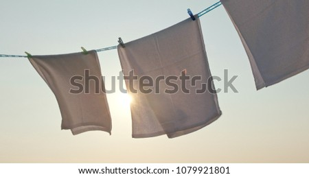 White towel drying under sunset
