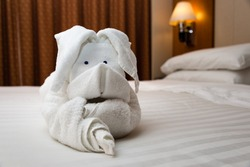 White towel folded into an origami rabbit on a cruise ship.