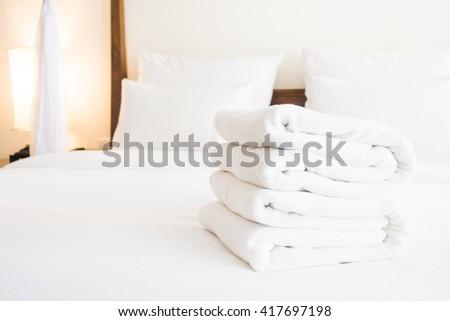 White towel on bed decoration in bedroom interior - Vintage light Filter