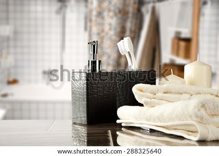 white towels and free space on top in bathroom