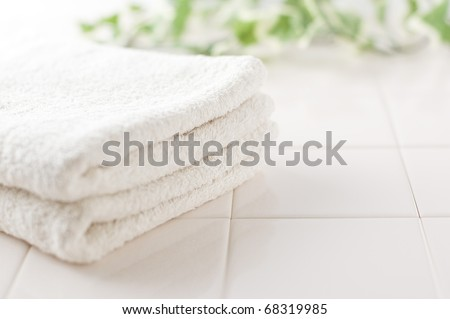 White towels and green on white tile