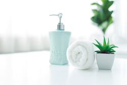 White towels and soap bottles placed on the table Spa concept