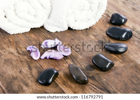 White towels and stones next to each other.