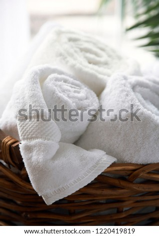 White towels in straw basket, selective focus #1220419819