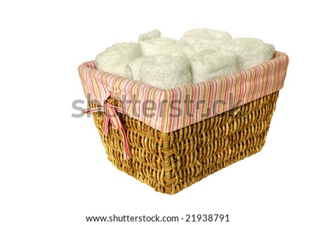 White towels inside a basket isolated on white