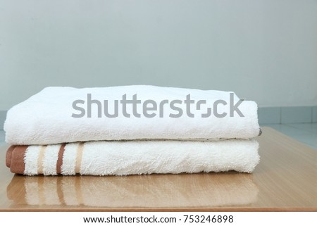 White towels look clean on wooden boards with space for placing objects in the picture. #753246898
