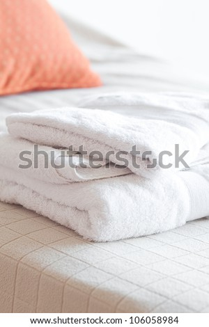 white towels lying on the bed