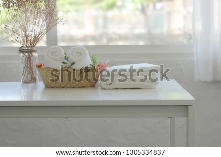 White towels placed on the white table in the room #1305334837