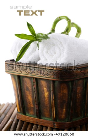White towels with green bamboo with sample text