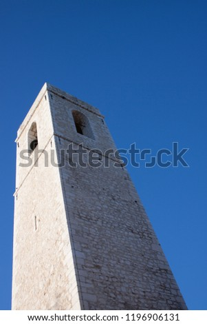 white tower bell in the blue sky