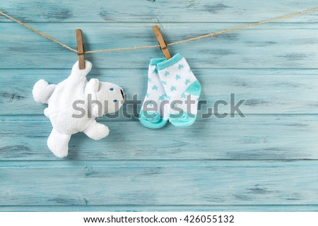 6b518a0bf White toy bear and baby socks with stars print on a clothesline #426055132
