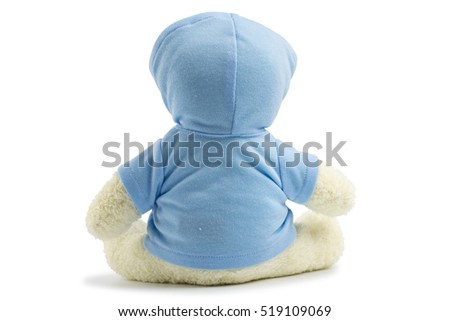 White toy teddy bear wearing a blue shirts and hat isolated on white background #519109069
