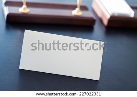 White triangular sign for the label standing on a table. Room for you text. #227022331