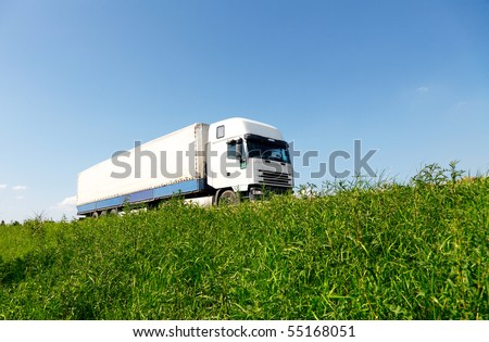White truck driving on the road