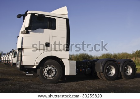 white truck fleet up close, place advert on white - stock photo
