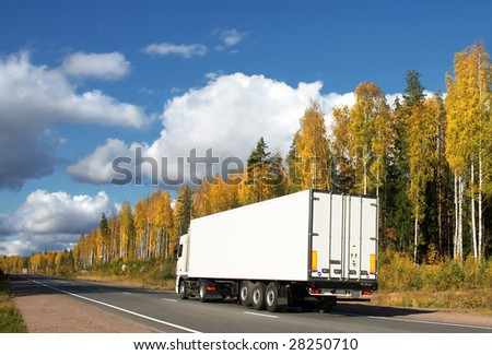 white truck on autumn highway