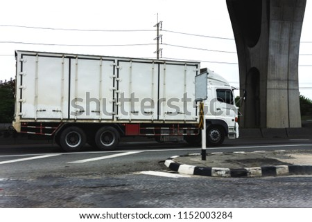 White Truck on highway road with container, transportation concept.,import,export logistic industrial Transporting Land transport on the expressway.motion blurred to soft focus #1152003284