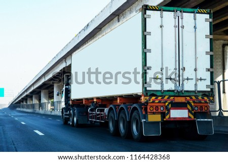 White Truck on highway road with  container, transportation concept.,import,export logistic industrial Transporting Land transport on the asphalt expressway #1164428368