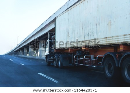 White Truck on highway road with  container, transportation concept.,import,export logistic industrial Transporting Land transport on the asphalt expressway #1164428371
