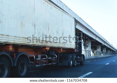 White Truck on highway road with  container, transportation concept.,import,export logistic industrial Transporting Land transport on the asphalt expressway #1167034708