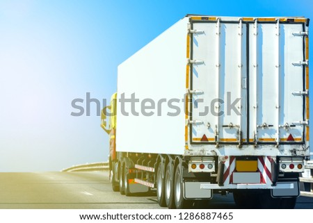 White Truck on highway road with  container, transportation concept.,import,export logistic industrial Transporting Land transport on the asphalt expressway With the blue sky #1286887465