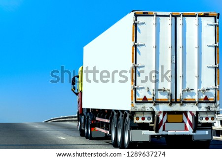 White Truck on highway road with  container, transportation concept.,import,export logistic industrial Transporting Land transport on the asphalt expressway With the blue sky #1289637274