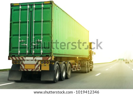 White Truck on highway road with green  container, transportation concept.,import,export logistic industrial Transporting Land transport on the asphalt expressway #1019412346