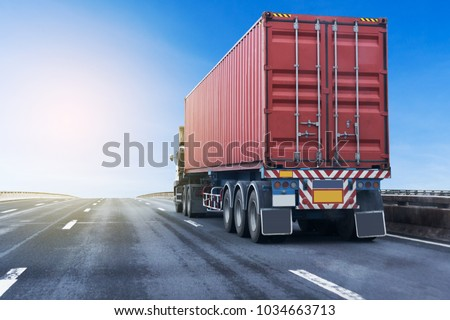 White Truck on highway road with red  container, transportation concept.,import,export logistic industrial Transporting Land transport on the asphalt expressway #1034663713