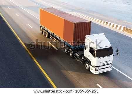White Truck on highway road with red container, transportation concept.,import,export logistic industrial Transporting Land transport on the asphalt expressway.motion blurred to soft focus