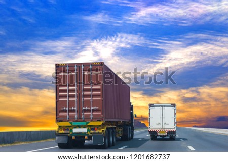 White Truck on highway road with red  container, transportation concept.,import,export logistic industrial Transporting Land transport on the asphalt expressway Against Sky During Sunset #1201682737